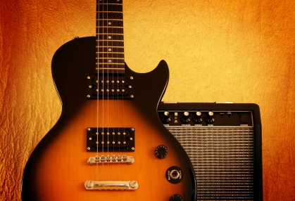 Les Paul guitar and fender amp